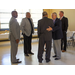 A group of men congratulating Mr. Byrd on his retirement