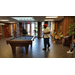 Residents enjoy a game of pool