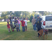 K-9 Officer doing maneuvers with his police dog for an audience of children