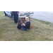 Two children crouching down to pet the K-9 dog