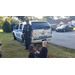 The two children petting the K-9 dog while the Officer watches intently