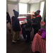 Three children mingling at the Winter Coat Giveaway